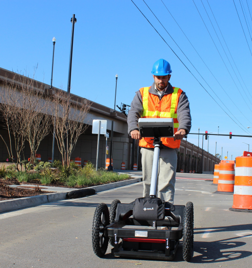 Man using EL HDR GPR utility locator for utility locating