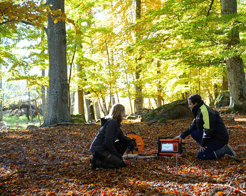 Two people surveying with resistivity meter